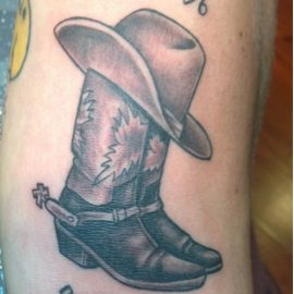 Tattoo cowboy boots and hat