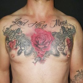 Rose and Guns Tattoos on Chest
