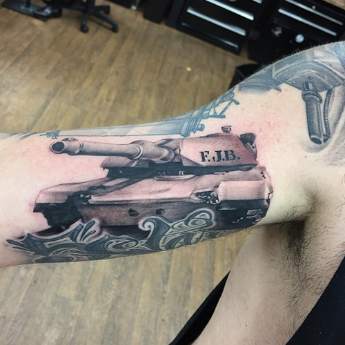 Tank Tattoo on Biceps