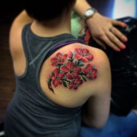 tattoos of flowers on shoulder blade