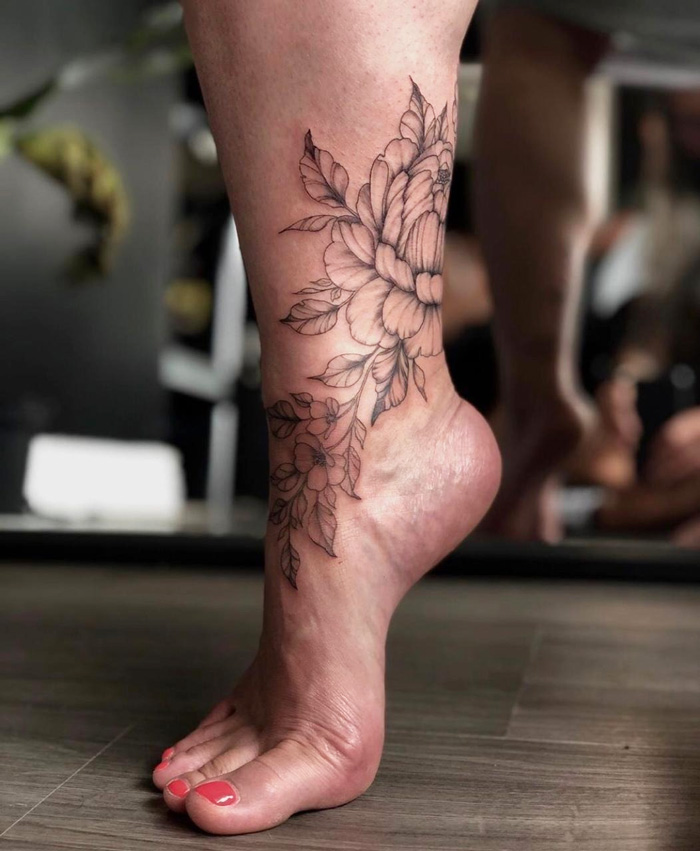 Rose And Vine Ankle Tattoo.