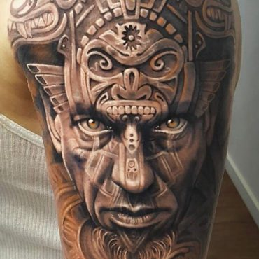 Aztec Face Tattoo on Bicep