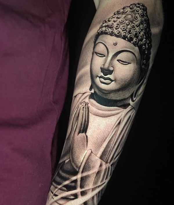 Tattoo Of Buddha Face.